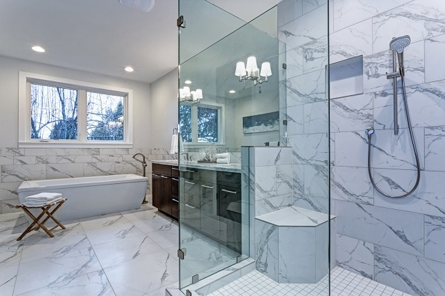 Incredible master bathroom with Carrara marble tile surround.